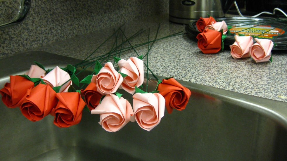 Roses attached to a stem, calyx semi-attached. Waiting for leaves, stem-wrapping, and a plastic cover